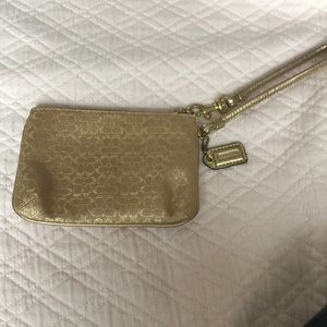 Coach gold wristlet with pink inside -like new